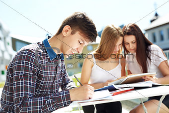 Portrait of three high school students spending time together
