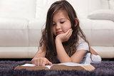 Little Girl Reading Bible on Carpet