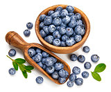 Berry blueberry in wooden dish with scoop