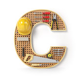Letter C. Alphabet from the tools on the metal pegboard isolated