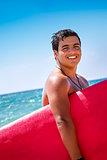 Cheerful surfboarder portrait