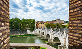 View of people walk on St Angel Bridge from Castel Sant'Angelo in Rome city