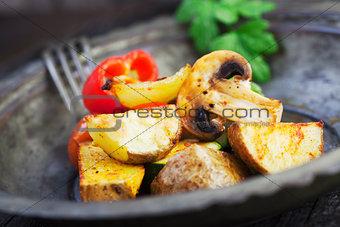 Roasted vegetables on wood