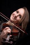 happy woman playing baroque violin