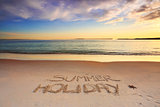 Summer Holiday etched into the sand of beach
