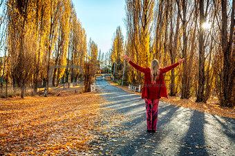 Woman enjoying countryside in Autumn