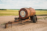 Barrel trailer with water on the field