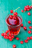 Redcurrant and glass of fruit drink juice
