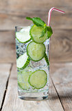 Cold fresh lemonade with cucumber, ice, mint and cocktail tube