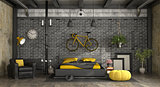 Black and yellow master bedroom in a loft