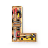 Letter L. Alphabet from the tools on the metal pegboard isolated
