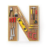 Letter N. Alphabet from the tools on the metal pegboard isolated
