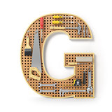 Letter G. Alphabet from the tools on the metal pegboard isolated