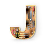 Letter J. Alphabet from the tools on the metal pegboard isolated