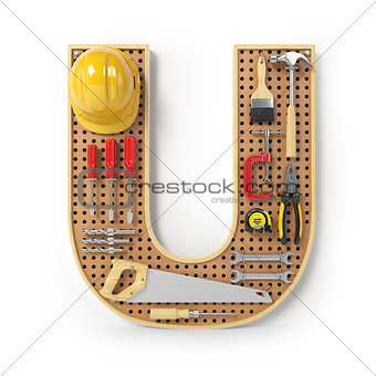 Letter U. Alphabet from the tools on the metal pegboard isolated