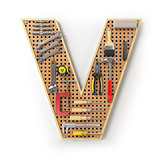 Letter V. Alphabet from the tools on the metal pegboard isolated