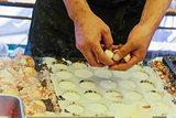 Closeup man make takoyaki