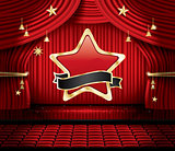 Red Stage Curtain with Star, Seats and Copy Space.