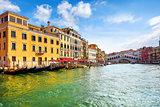 Venice, Italy. Gondolas on Grand Channel. Panorama view at Rialto Bridge. Piers