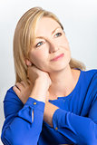 Studio Portrait of Healthy Thoughtful Middle Aged Woman