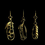 Luxury hand drawn golden feathers isolated on a black background. Vector elements for your design.