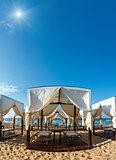 Tents canopies on sunshiny beach