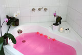 bathtub with pink water