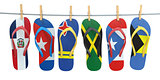Hanging flip flops in colors of flags of different carribean cou