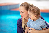 Mother with son near pool