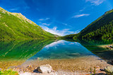 Blue Lake Morskie Oko and the green mountains of Tara, Poland