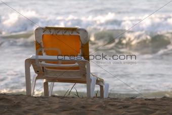 Chaise longue on the sand beach