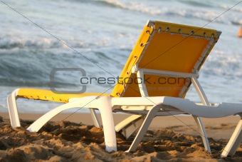 Chaise longue on the sand beach