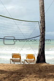 Chaise longues and Volley net on the beach