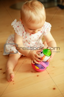 Baby plays with toys
