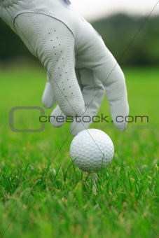 Detail of golf ball and gloves