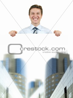 Business man holding a white board with corporate buildings