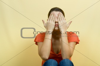 woman closes eyes hands