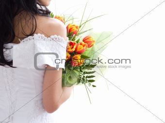 Beautiful bride with bunch of tulips