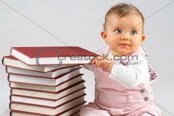 small baby and books