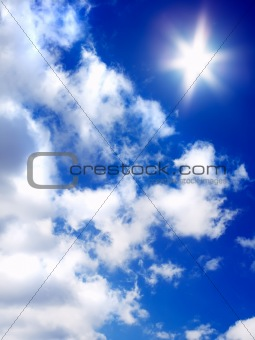 sun and clouds on blue sky