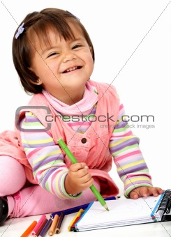 girl colouring on a notebook