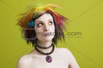Punk woman with bright makeup and bare shoulders