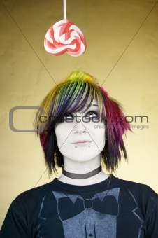 Alternative Girl Looking at a Heart Lollipop