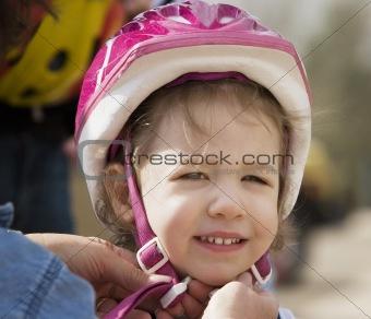 Little girl in a bicycle helmet