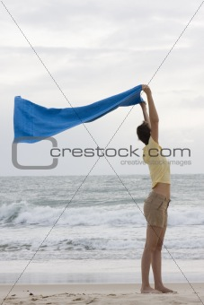Woman with towel on beach