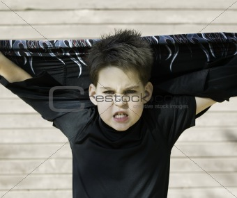 Boy with his shirt behind his head