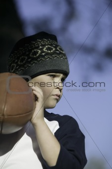 Young Boy With a Football