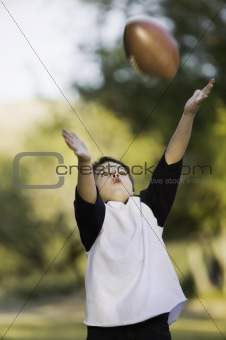 Boy catching a football