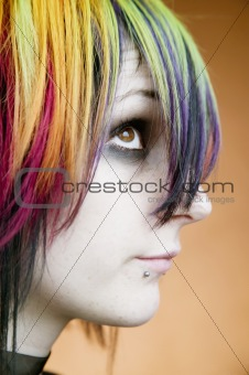 Alternative girl with multi-colored hair looks up