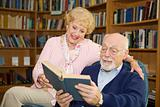 Senior Couple Reads Together